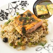 A plate with rice pilaf and salmon.