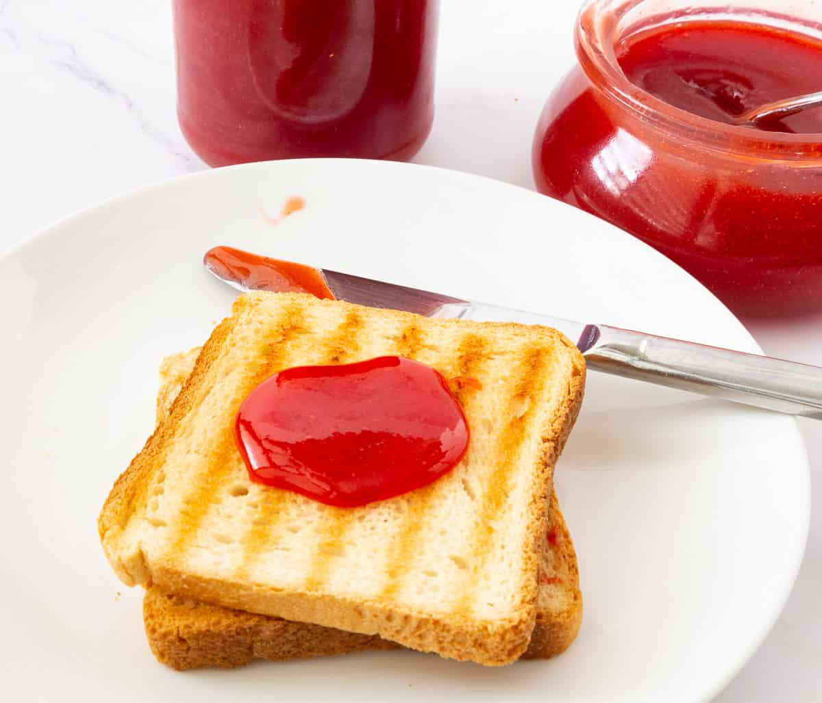 A toast with strawberry jelly.