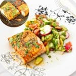 Plate with salad and pan fried salmon in honey garlic.