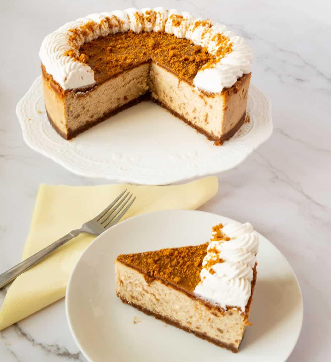 A sliced cheesecake with bsicoff glaze.
