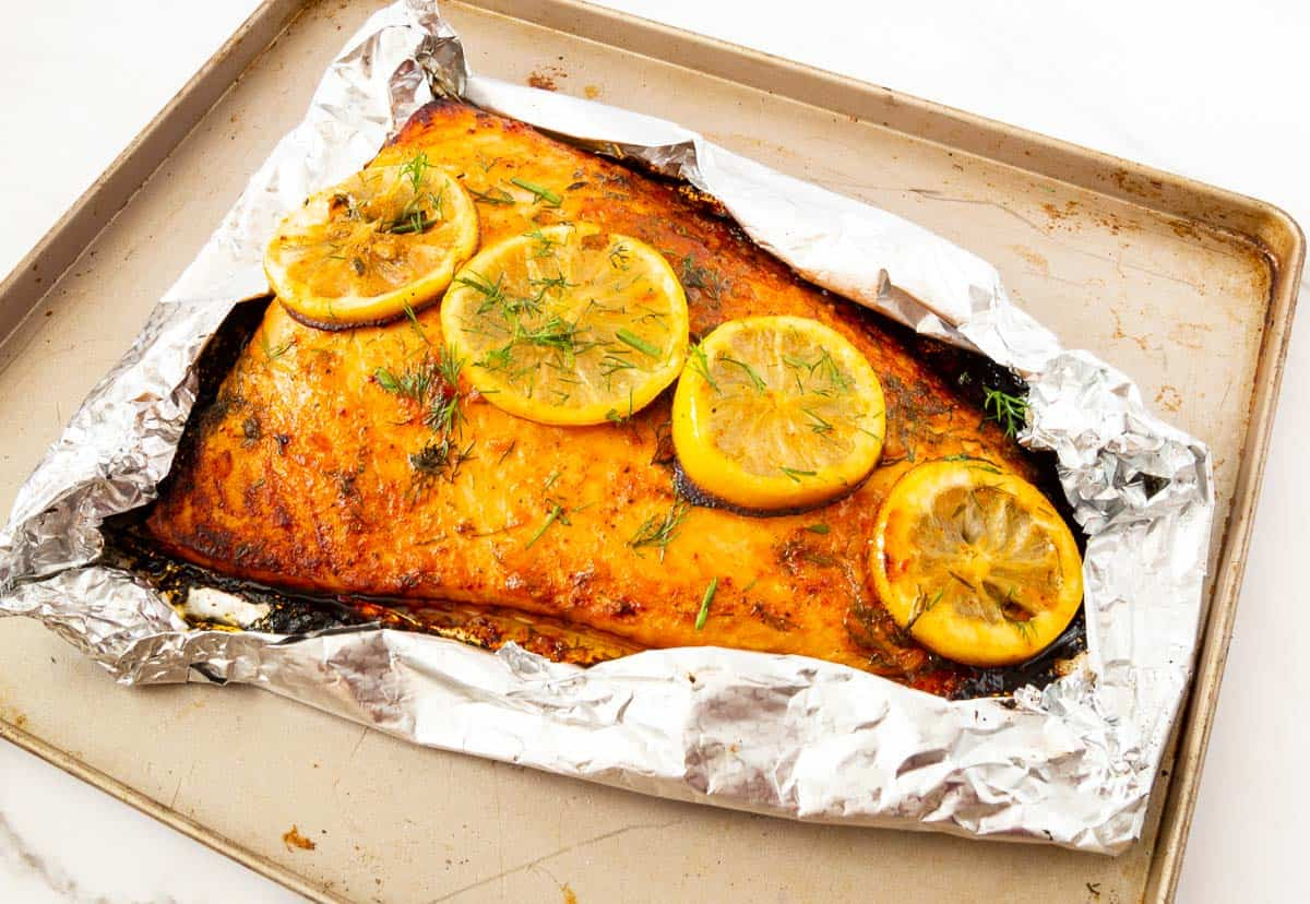 Salmon cooked in foil on baking tray.