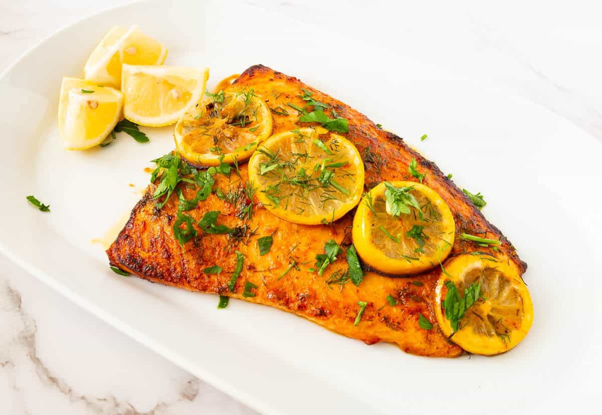 Baked salmon served on a platter