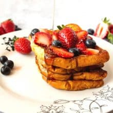 Slices of Brioche French Toast on a white plate.