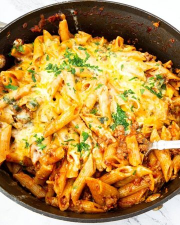 A skillet with ground beef and pasta.