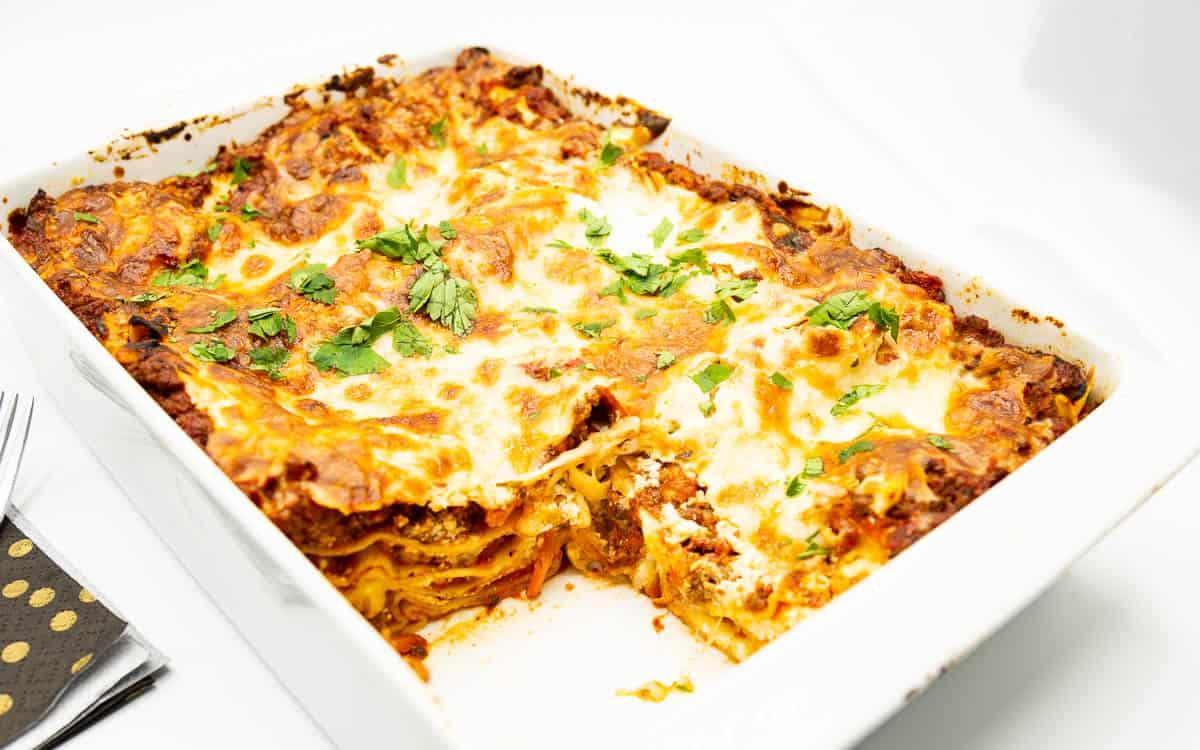 A baking dish with sliced lasagna.