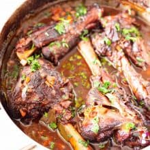Shanks of lamb in a Dutch oven.