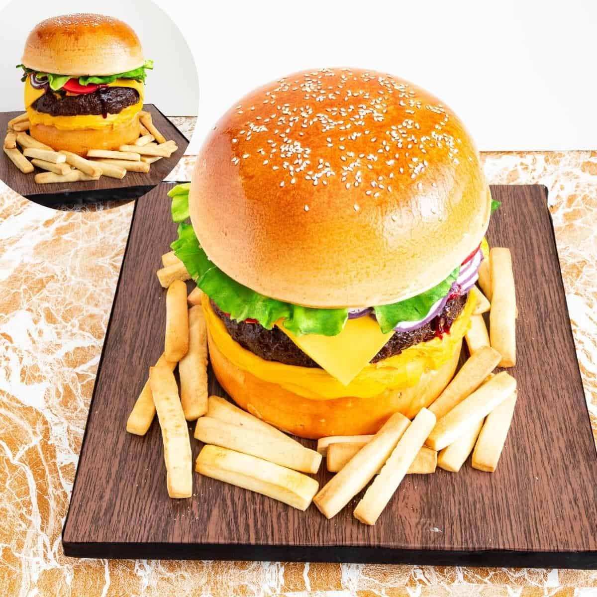 A cake shaped like a burger with fries on a cake board.