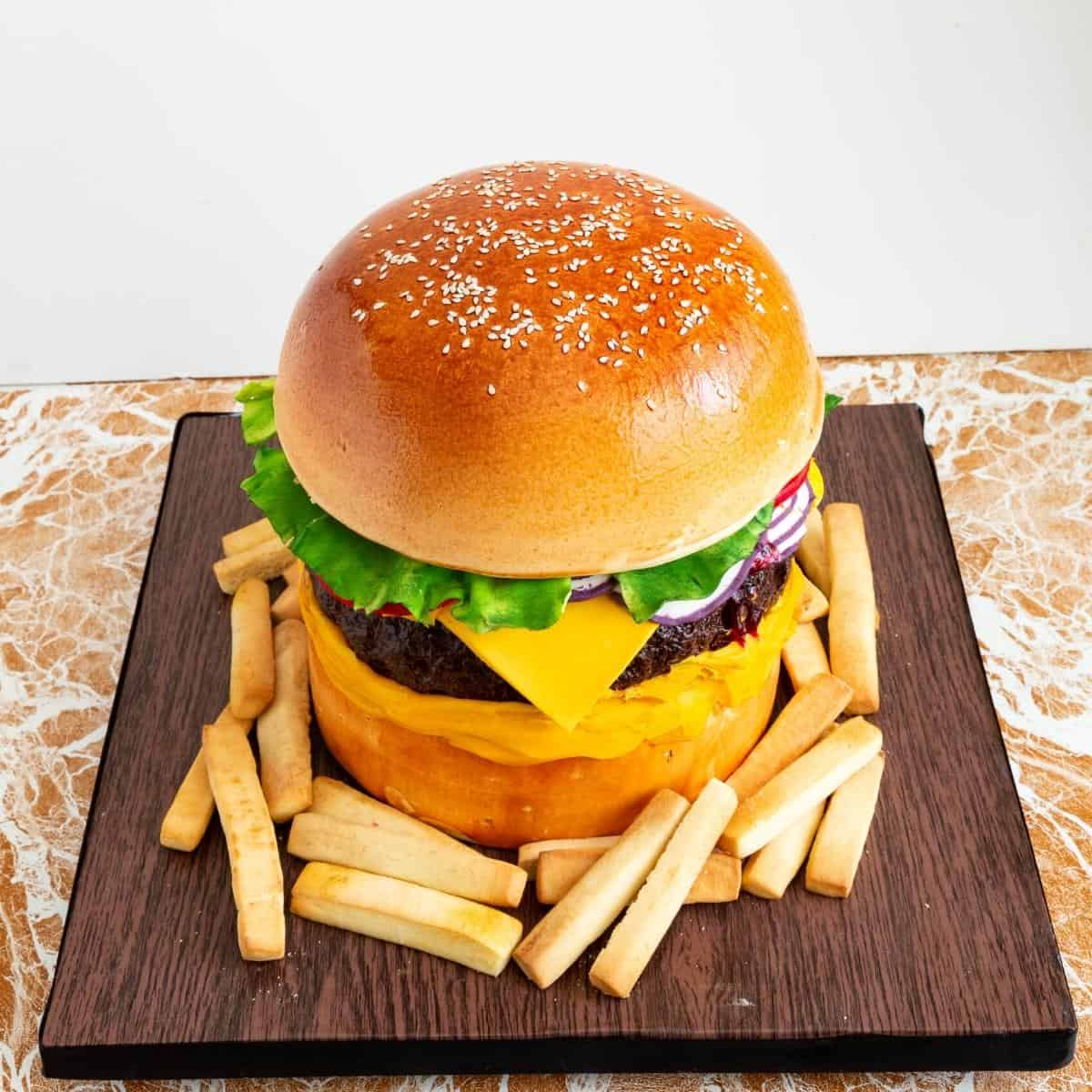 Cake on a cake board with French fries.