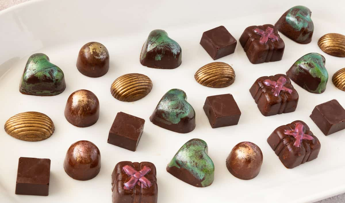 A platter with various chocolate bonbons.