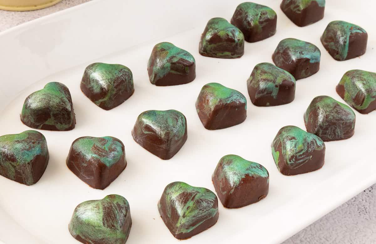 Heart shaped bonbons on a plate.