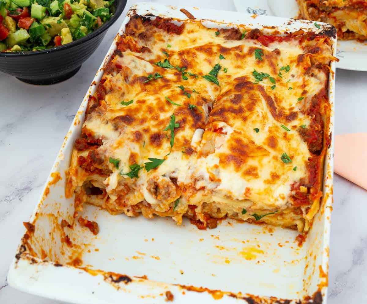 A casserole dish with baked lasagna béchamel.
