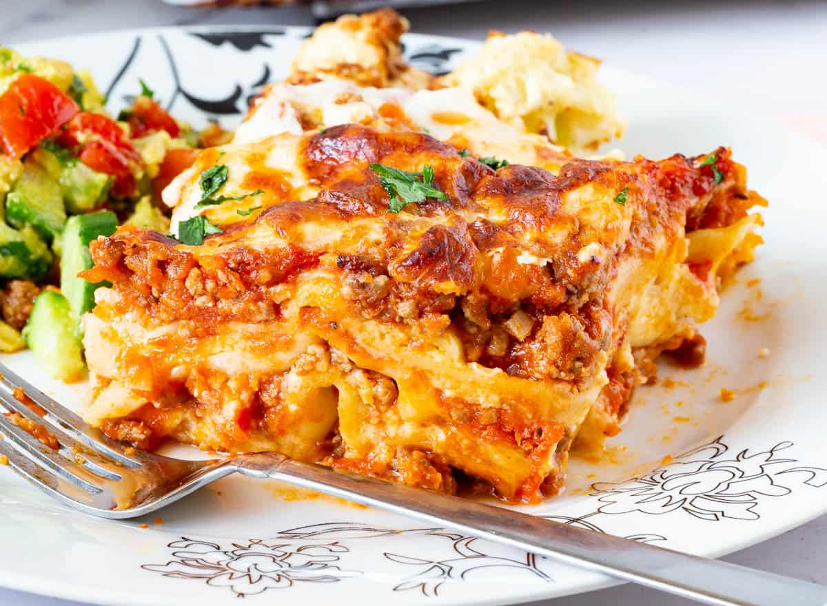 A plate with lasagna on a plate.