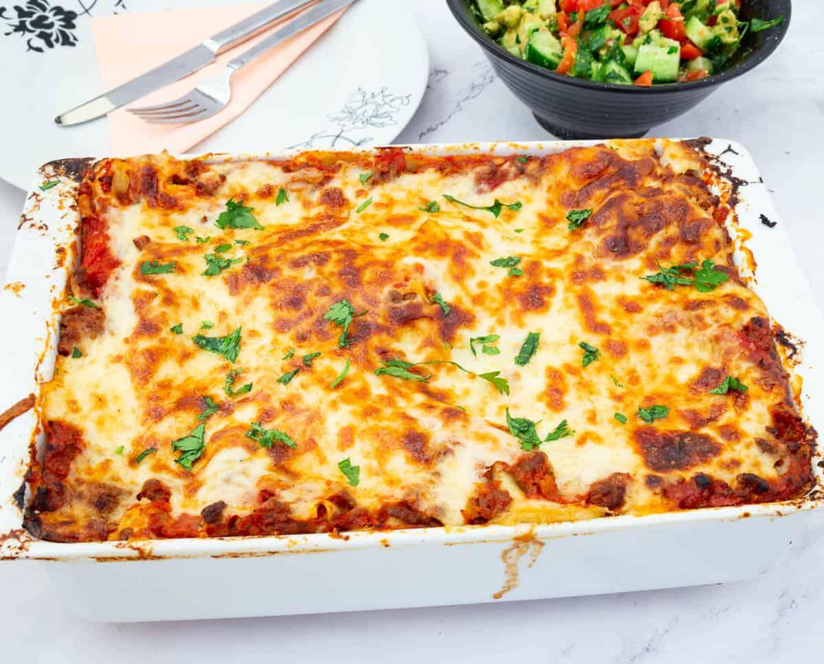 A ceramic dish with lasagna.