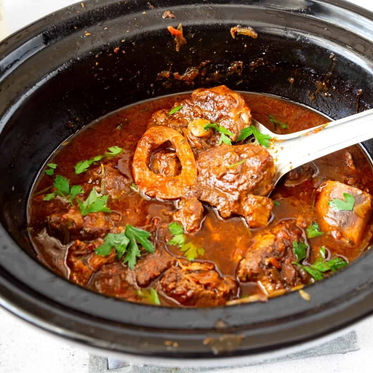 A slow cooker with shanks.
