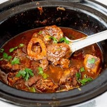 A slow cooker with veal shanks.