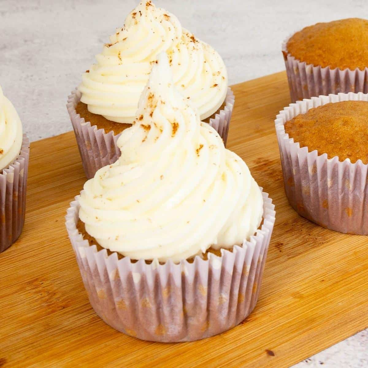 Frosted cupcakes dusted with nutmeg.