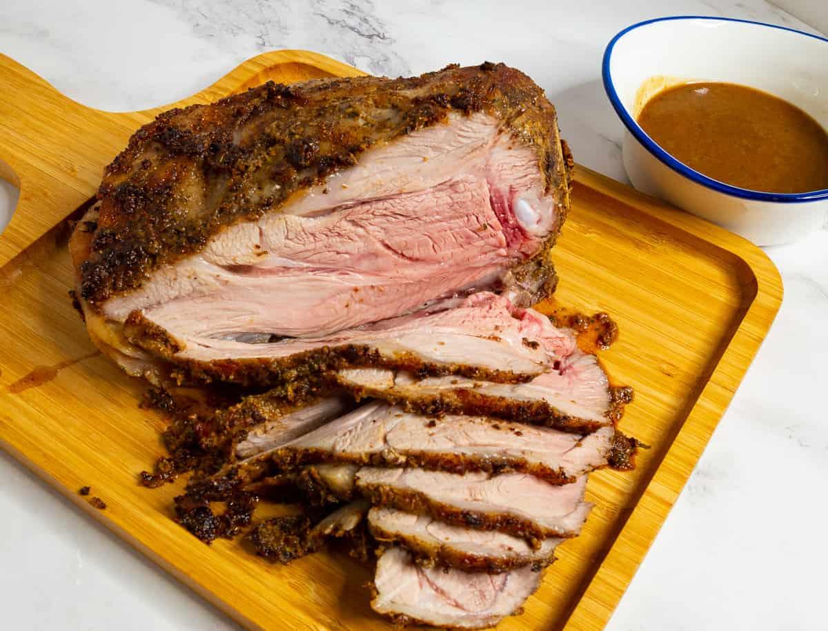 Lamb shoulder roasted slices on a board.