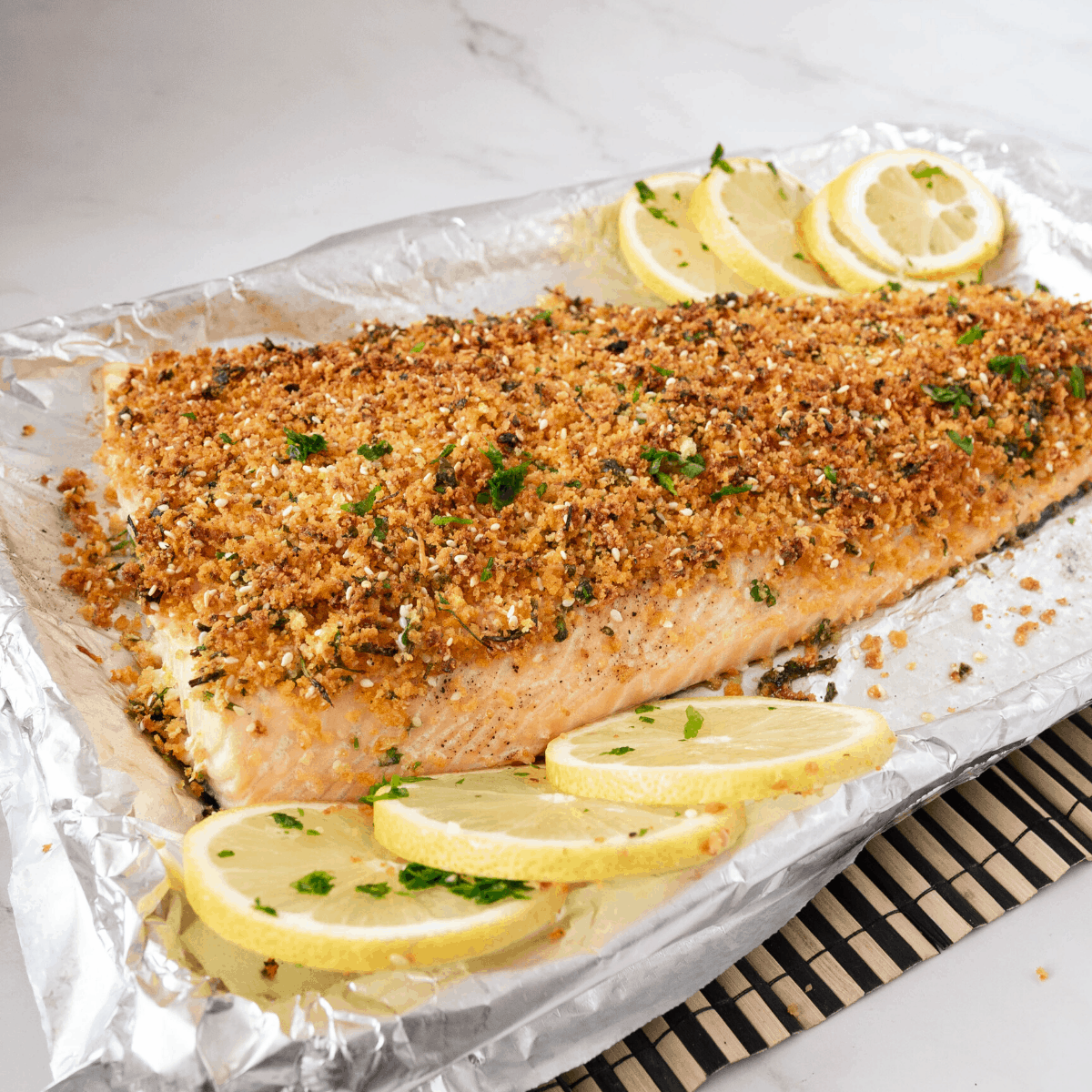 A baking tray with salmon baked.