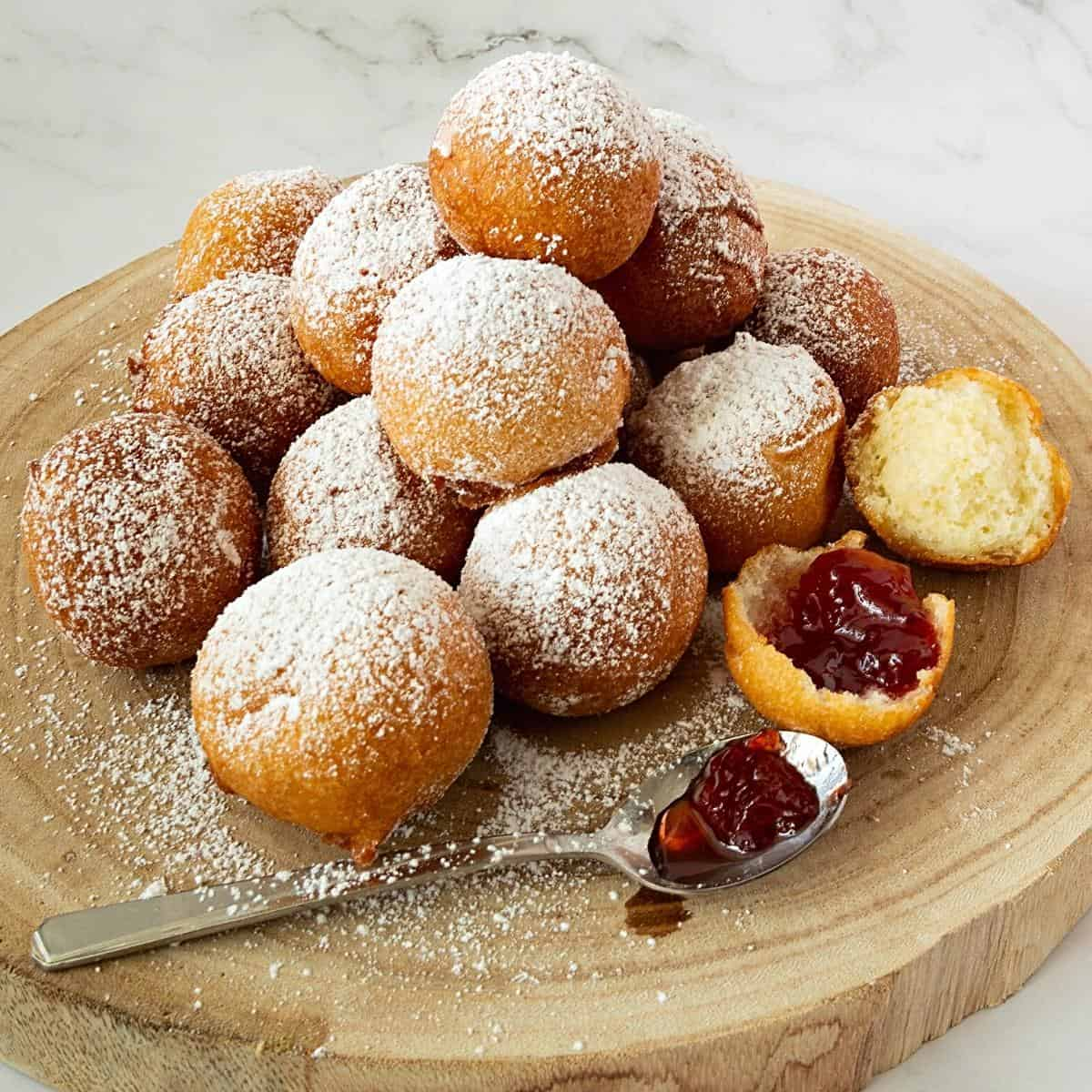 Donut holes on a wooden board.