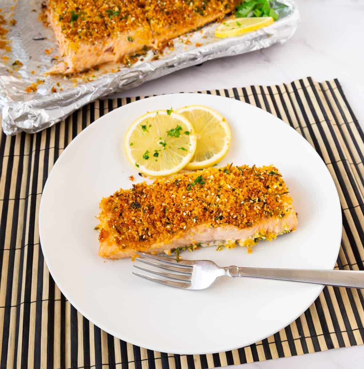 A plate with parmesan crusted salmon.