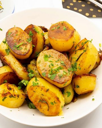 Cooked potatoes in a serving dish.